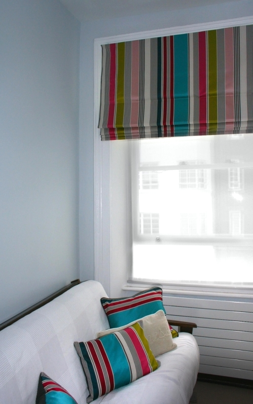 Roman blind with vertical striped multi-colour fabric