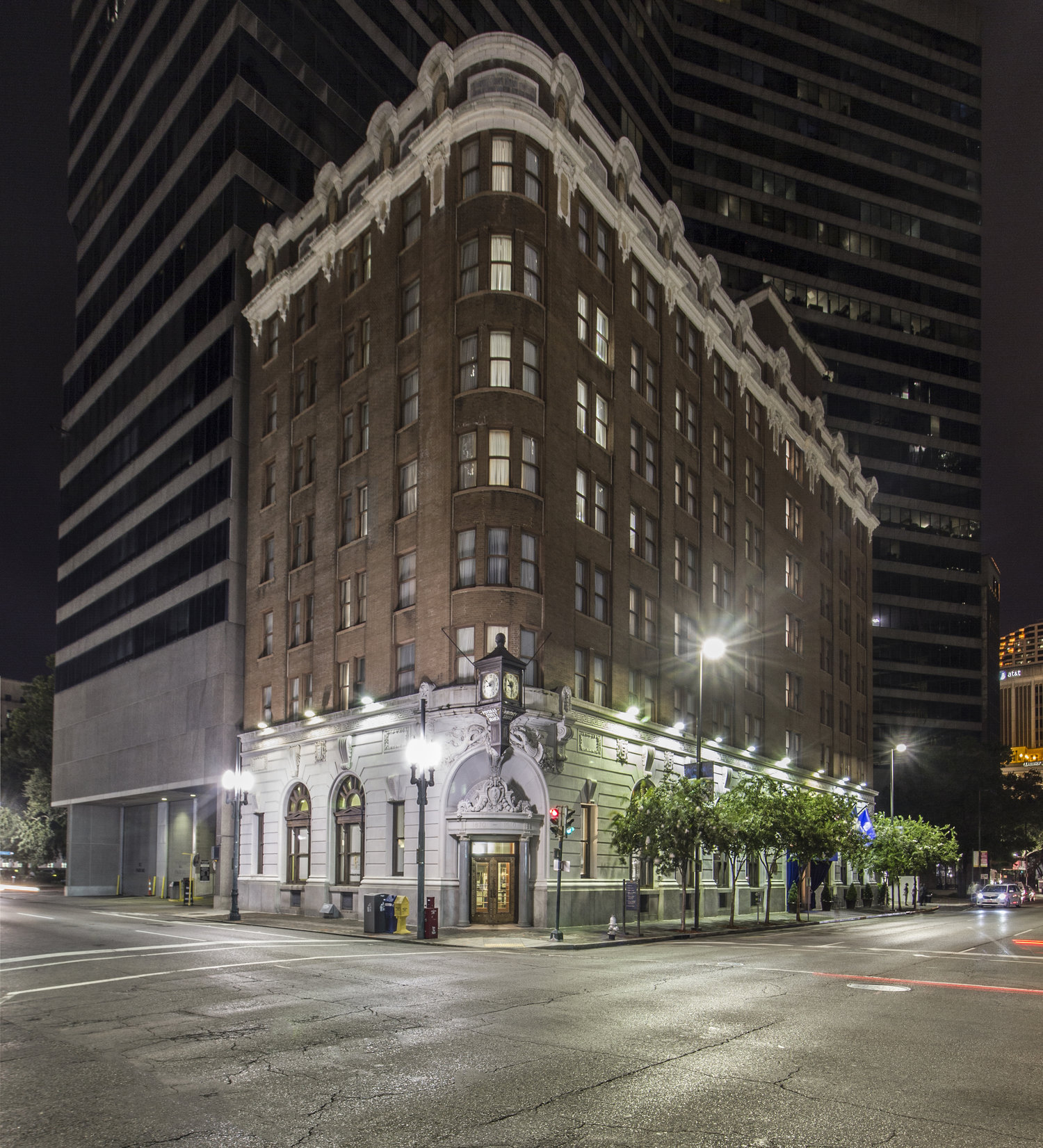 """""""Night"""" shot taken at 4am to eliminate parked cars. Strong architectural style highlighted with forced perspective. By darkening nearby buildings, property stands out among competing surroundings."""
