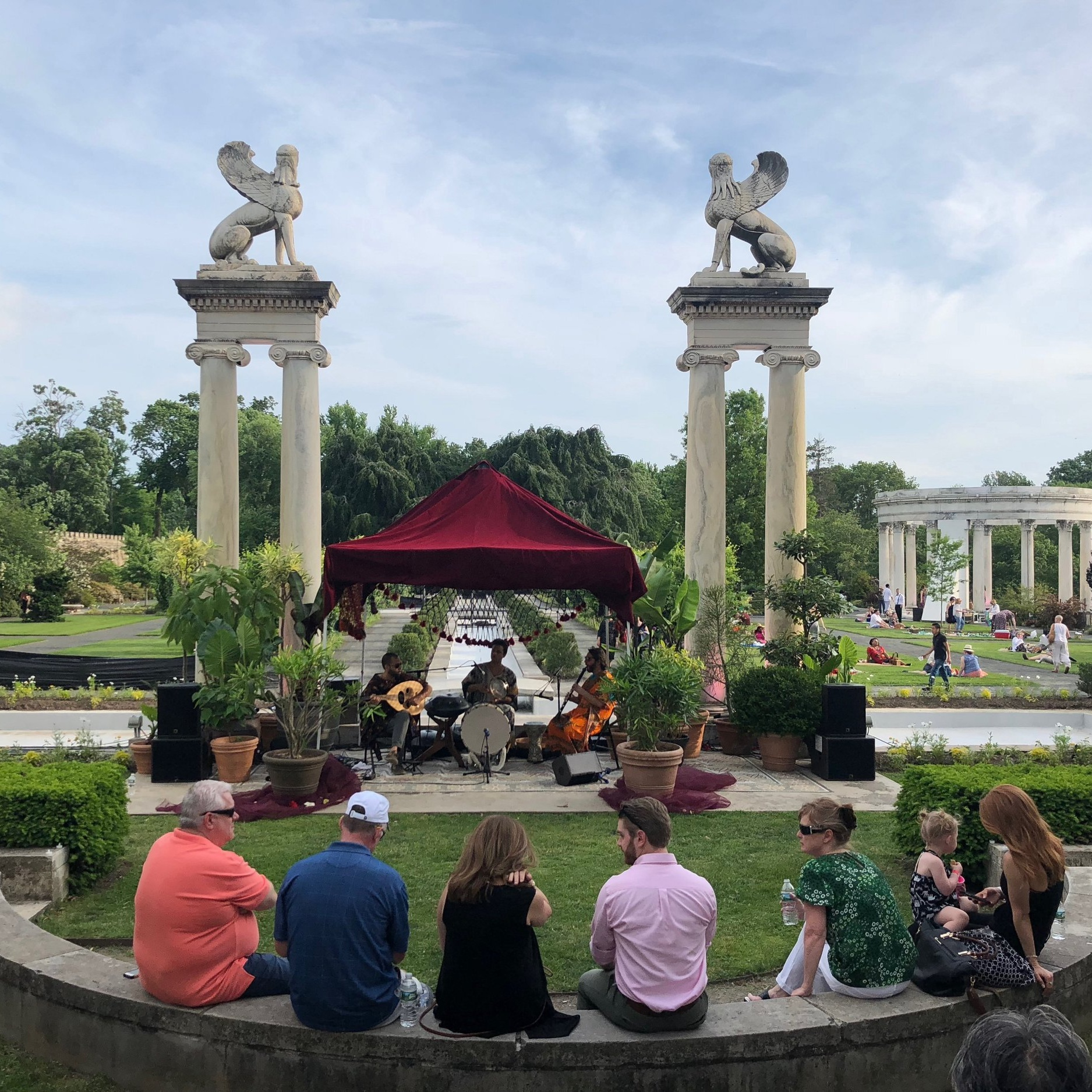 An Evening of Picnicking, Music, and Performance Art at Untermyer Gardens - Looking to escape the city, but not quite up for a rock scramble at Breakneck Ridge or the crowds in Cold Spring? Take the Metro North to Yonkers and make your way to Untermyer Gardens Conservancy, where you can stroll around beautiful parks filled with Roman columns, sphinxes, waterfalls, a walled garden with towers straight out of a fairy tale, and more!. I got to spend an evening at Untermyer after hours for the second annual Great Forgotten Garden Party produced by Atlas Obscura…