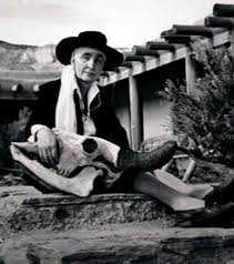 Georgia O'Keeffe at Ghost Ranch, with skull, 1948. Gelatin silver print. Phillipe Halsman
