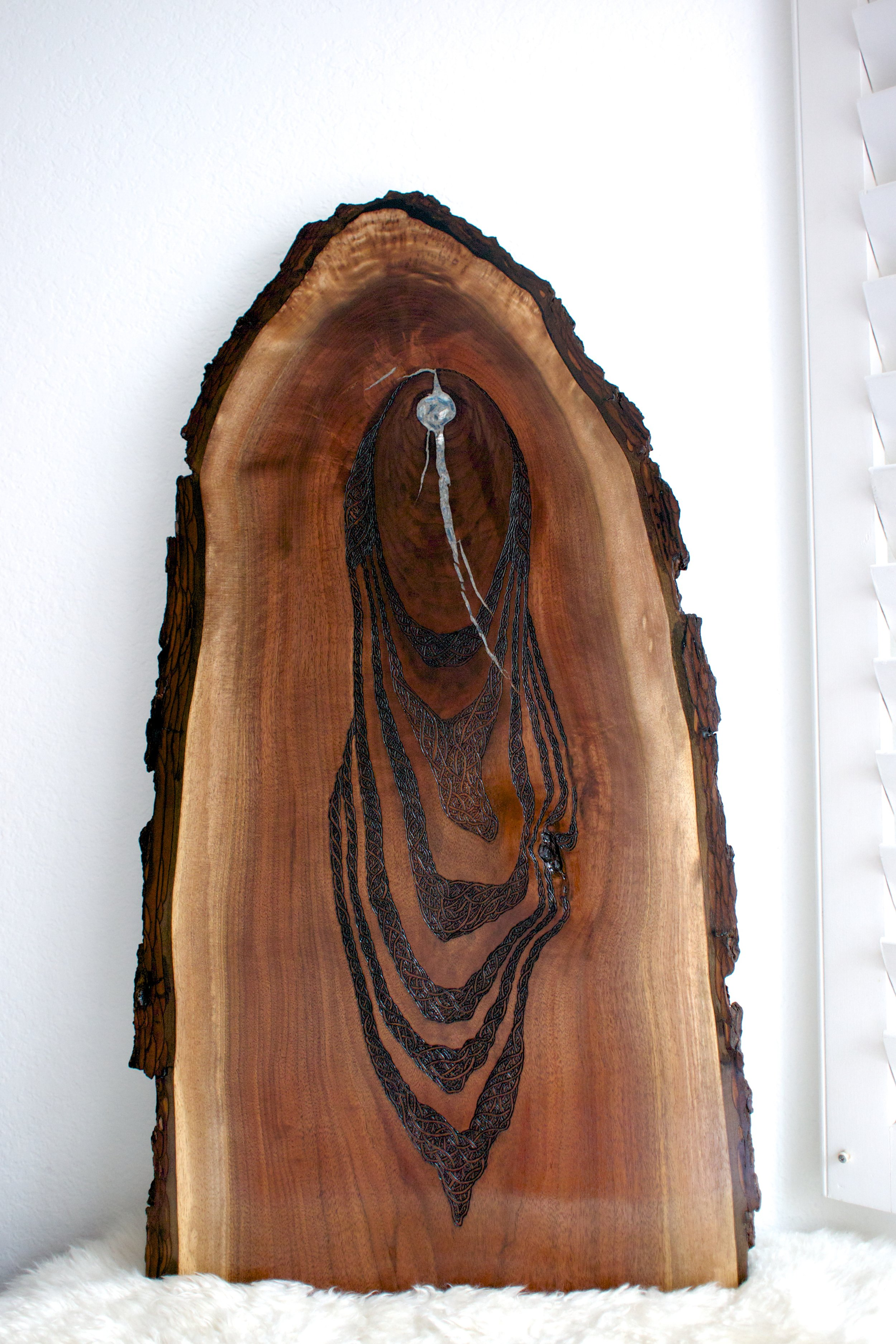 Shape Shifter (2016)  Wood Burning on Black Walnut Live Edge Slab Kyanite Crystal Inlay 37 in x 2 in x 18.5 in $4,000.00   For Inquiry Email bzartsgallery@gmail.com