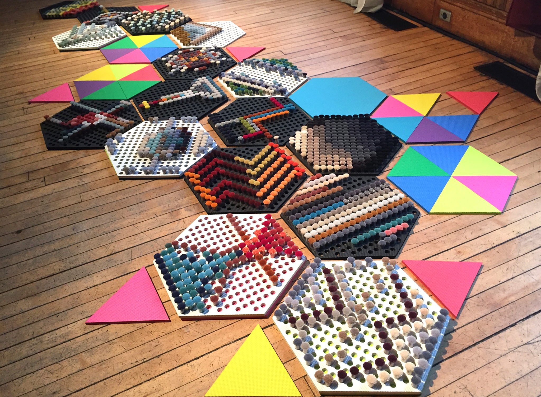 Woven Space  | Art installation made for Come Up To My Room festival put on by Gladstone Hotel | An interactive art experience where guests were invited to create patterns with the carpet poms | 2017