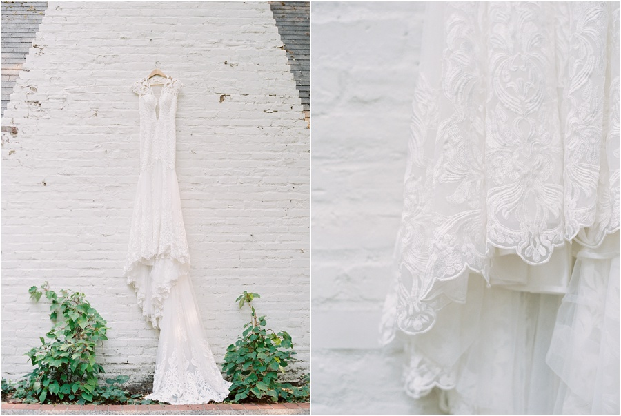 Romantic bohemian white wedding gown drapes effortlessly against the garden wall.