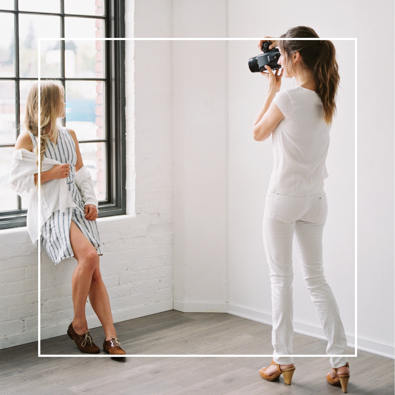 Betsy Tomasello editing photographs for Betsy Blue Photography in home photography studio in Medford, Oregon.