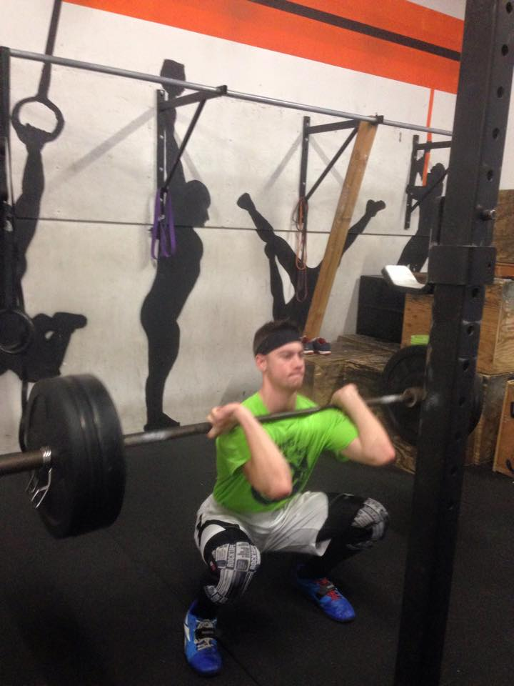 Austin exercising some awesome squat mechanics and excellent headband etiquette.