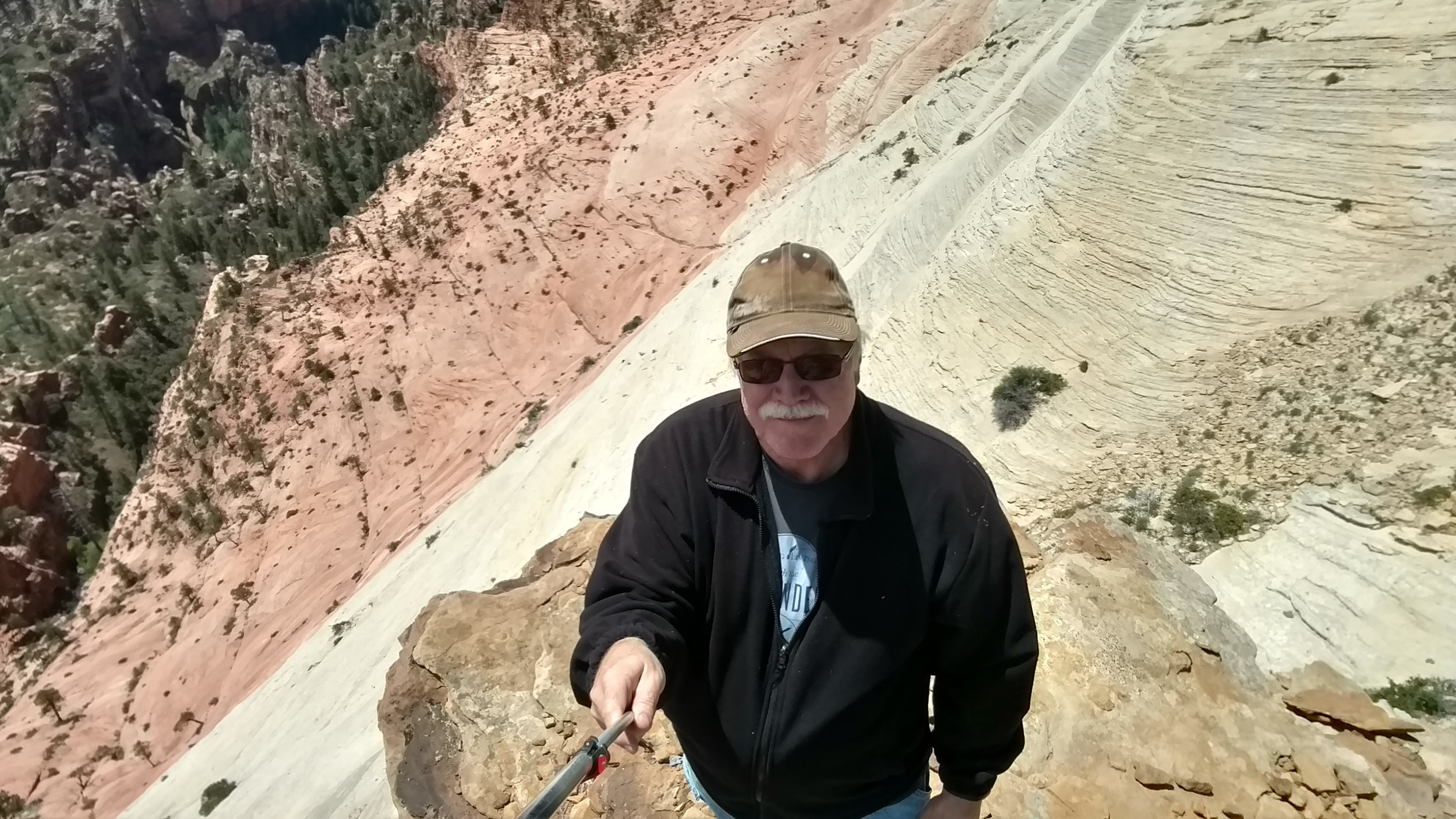 Selfie showing the rocky outcropping and dramatic drop off to the Subway.