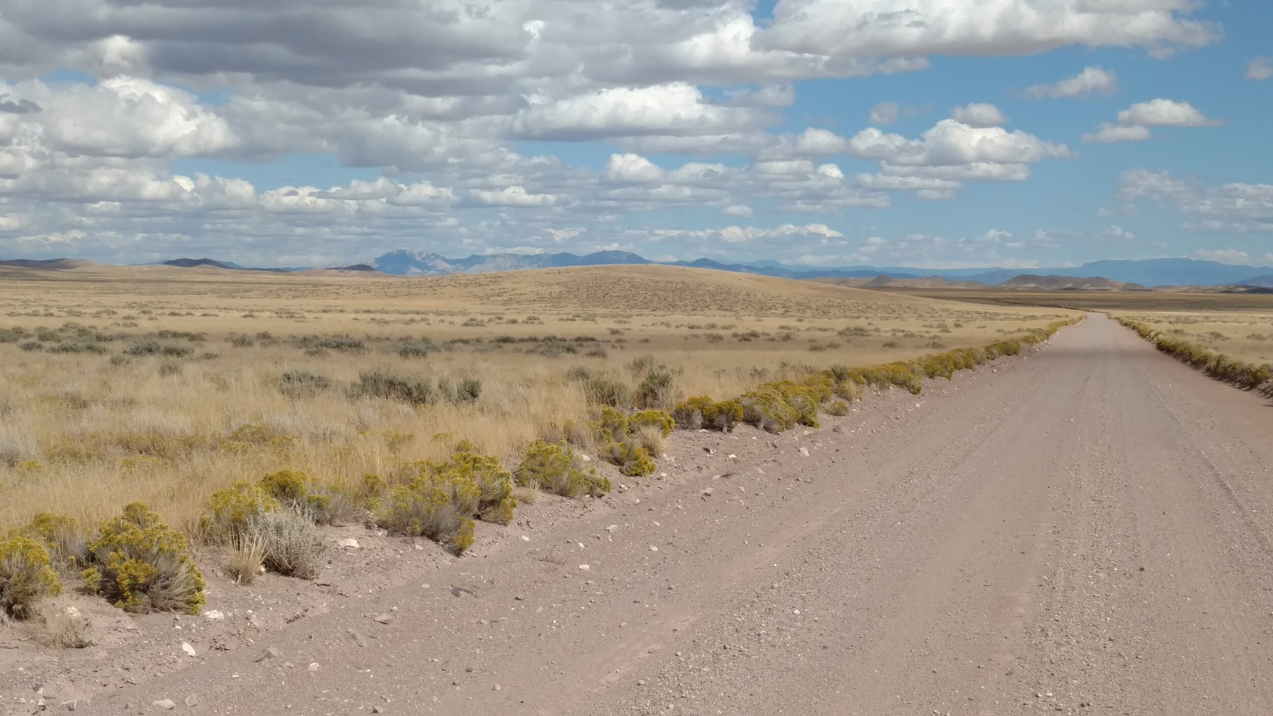 Burns Knoll (Brown Bump picture left of road); Beaver County; Burns Knoll-UT quad; Rise 33'; UT Rank: unranked.