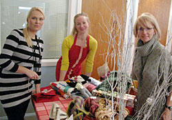 Finland Center volunteer Henna Hallstrom (L) and treasurer Helena Niskanen (R) at the bazaar table, with Heli Sirvio of the Finnish Church in the middle.