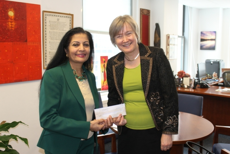 Deputy Executive Director Lakshmi Puri receives the check from Jaana Rehnstrom.