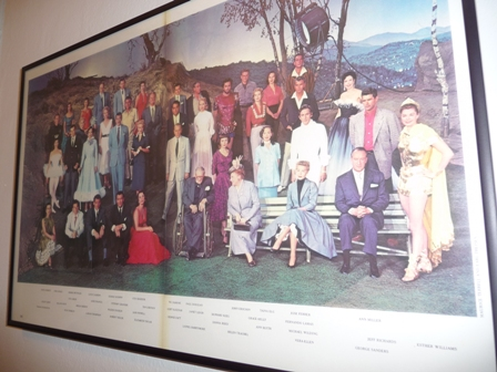 One day at MGM all actors and actresses who were present that day were called in for a group photo. Taina Elg second from the right in the back row wearing a red shirt.