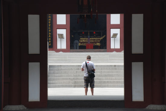 About to kneel in front of a giant Buddha at a monastery / temple on Purple Mountain in Nanjing.