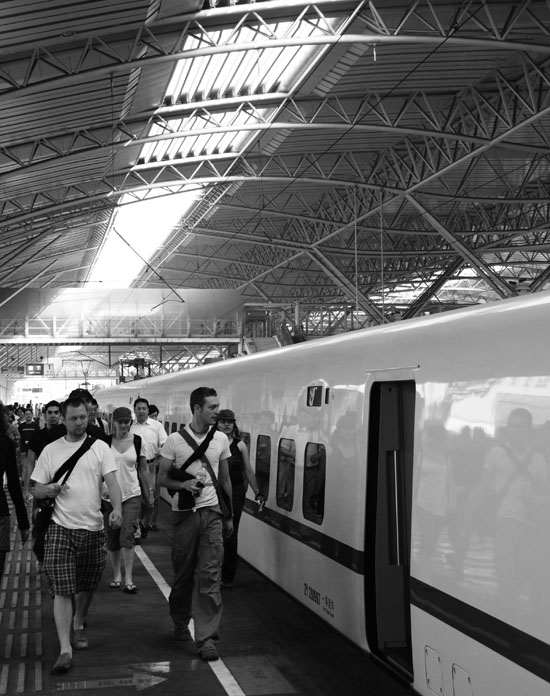 Train station from Nanjing to Shanghai. I didn't get to ride the electromagnetic train that goes like 450 mph, but this one was nice. Wait, no it wasn't. The only beer they had was warm Budweiser in faceted cans. And they only had 18 of those for a train of several hundred. My friends and I drank the train dry in about 4 minutes.