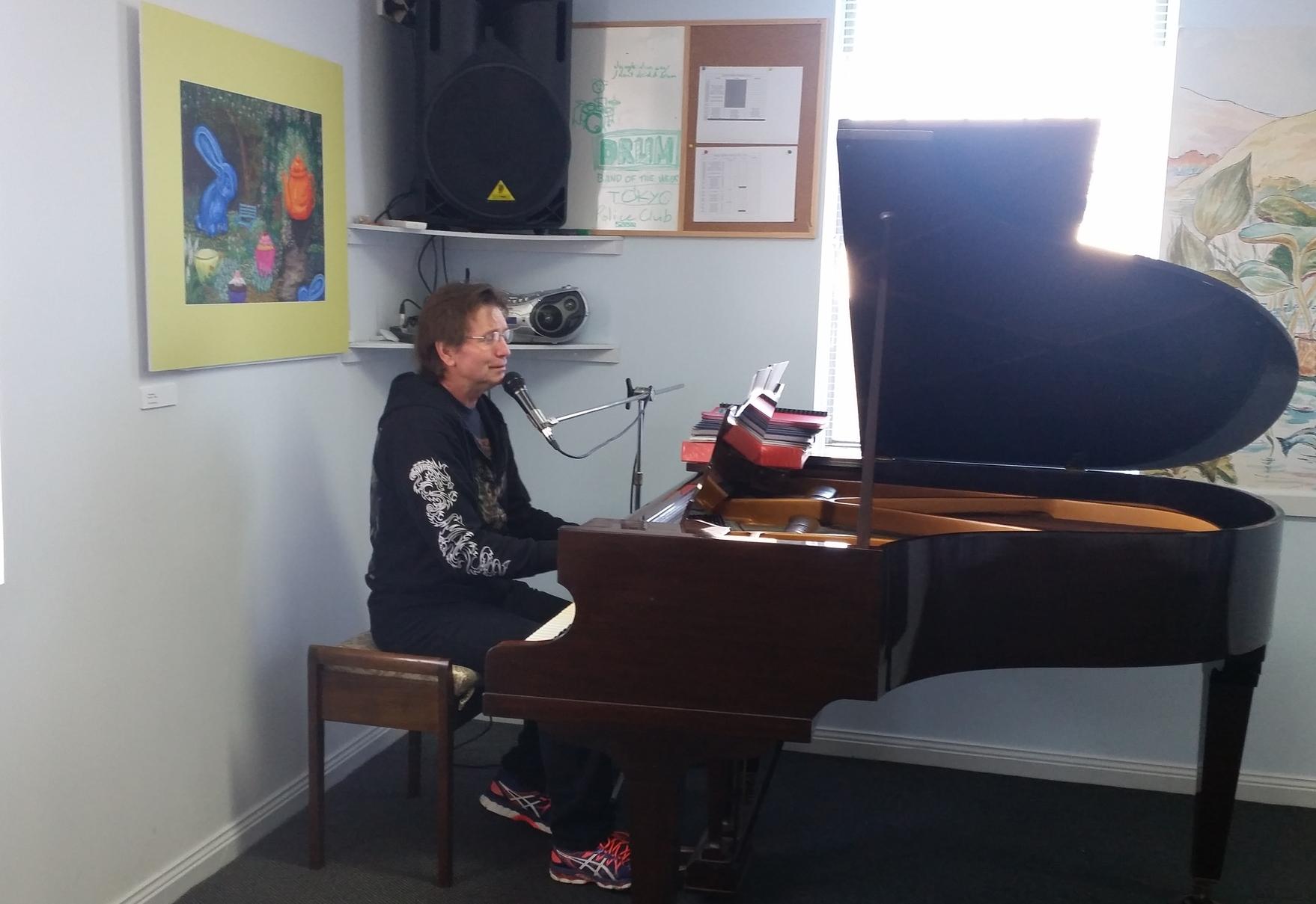 Philip Snitch on piano.