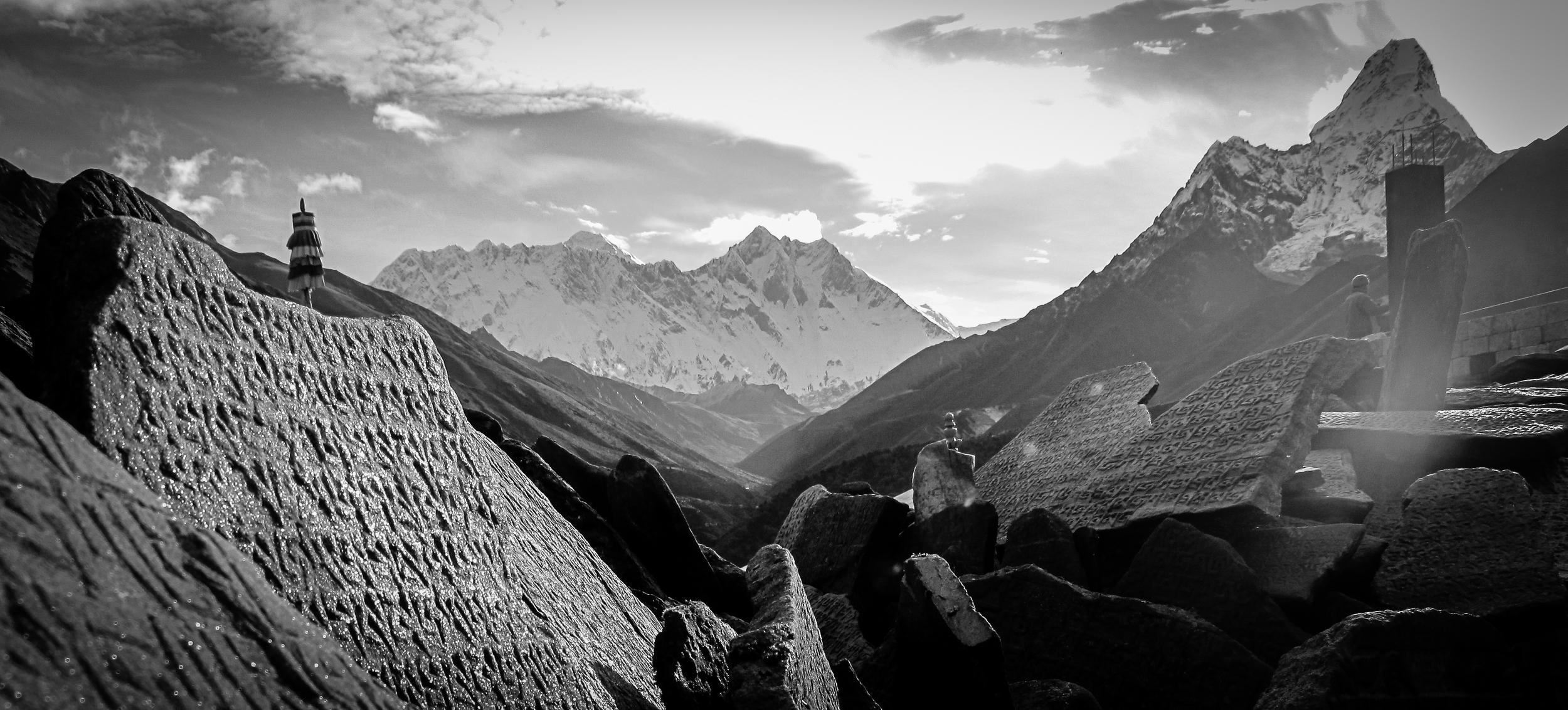 Sherpa script on stones below Mount Everest, Lhotse, and Ama Dablam, Nepal