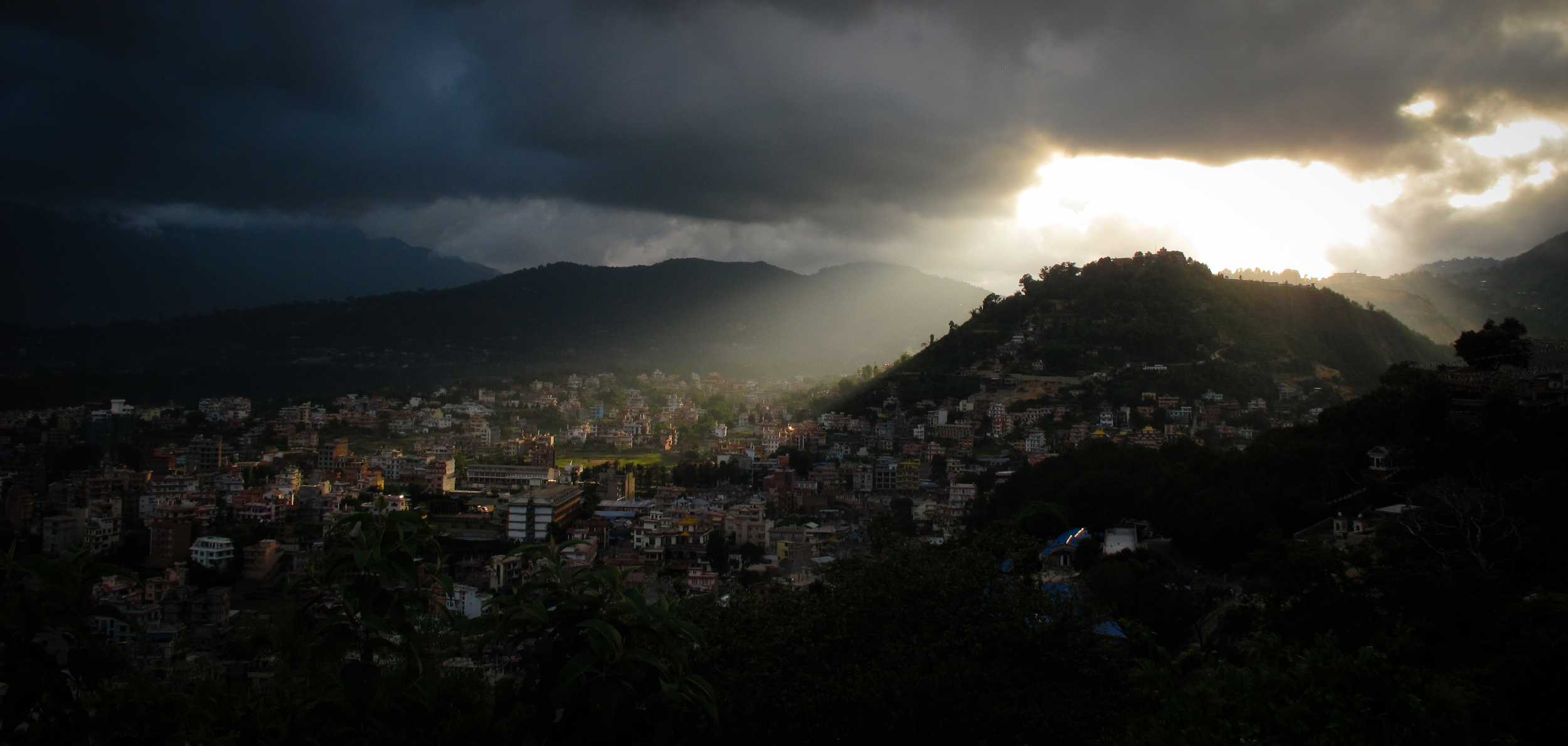 Light streaming through monsoon clouds, Kathmandu, Nepal