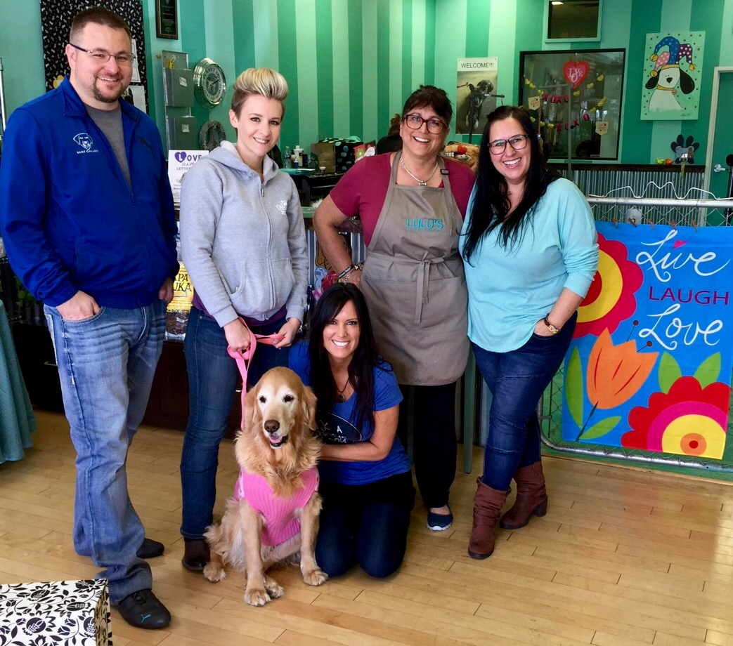 Pictured from Left to Right: Rick Vierkandt ( Bark Gallery ) Rachel Roberts-Levi ( One Family Animal Sanctuary )  Pam Webb ( Rockin 4 Rescues ) Joni ( Lulu's Doggy Salon and Spaw ) Sam Ratcliffe ( Rockin 4 Rescues ) and Lucie Honeybun Levi!