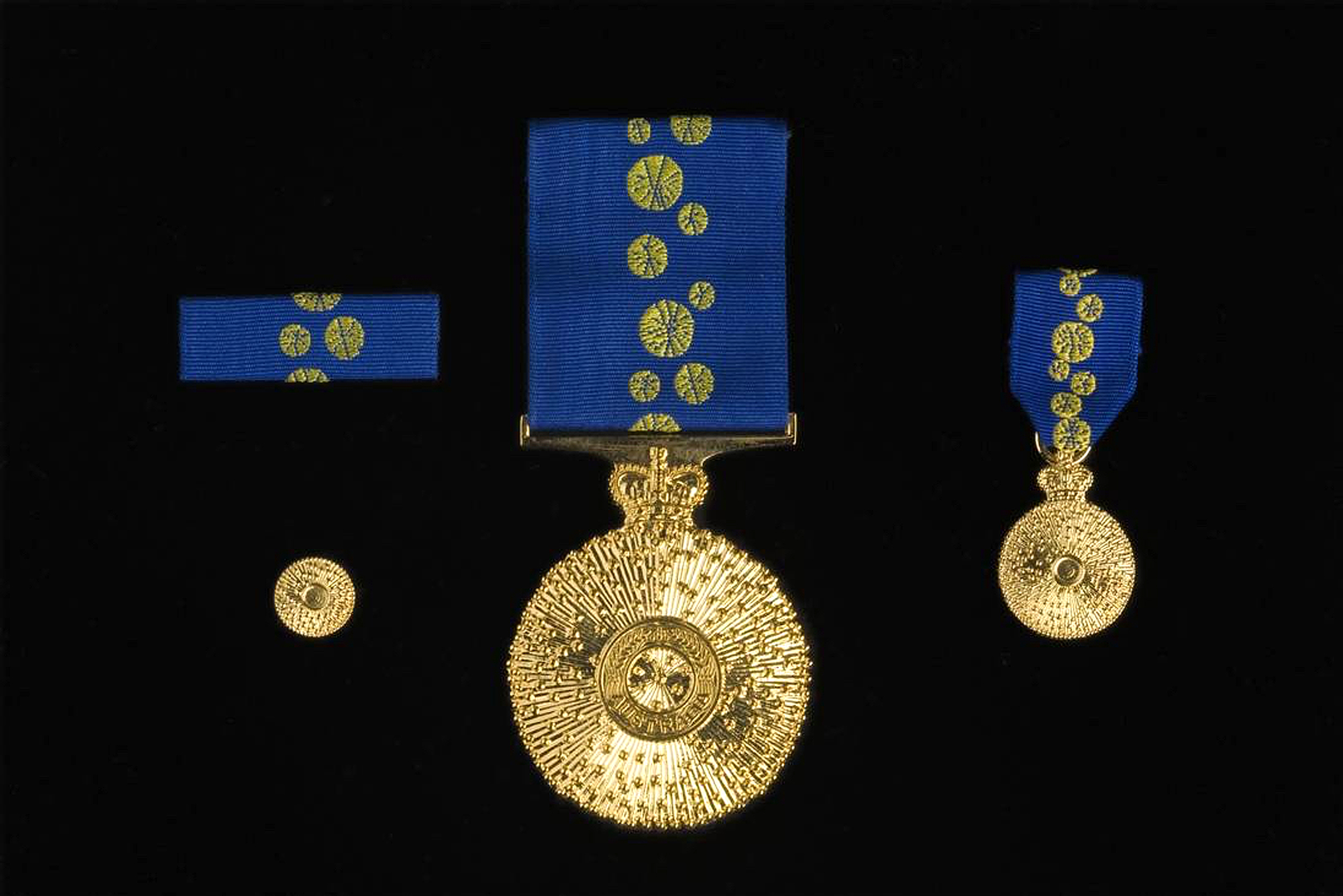 The Order of Australia is the highest honour an Australian civilian can receive. The insignia and ribbon are designed around a wattle blossom. Image courtesy of the National Museum of Australia.