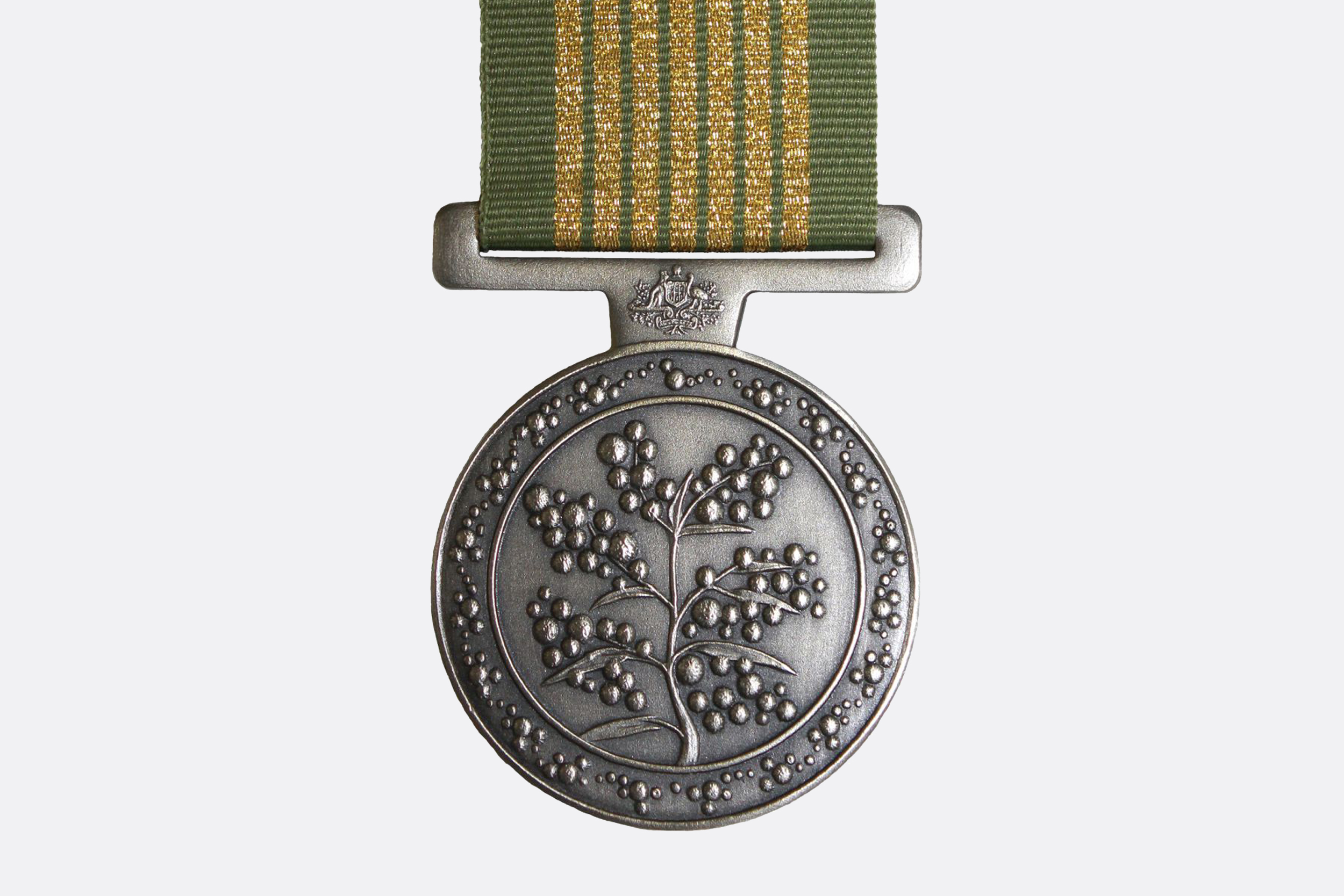 The National Emergency Medal is an award of the Australian honours system given for sustained service during a nationally significant emergency. The central image is a stylised representation of wattle. The image around the central image is a flowering wattle, representing the accomplishments and sacrifices made by Australians in the service of others in times if crisis. Image courtesy of the Office of the Official Secretary to the Governor-General (OOSGG).