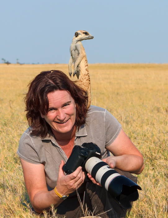 Anette Aossbacher on location in Africa. As a young child, her forester father taught Anette how to become still, disappearing into nature's (and meerkat) rhythm. That skill has helped her become one of the world's best nature photographers. Image: Courtesy of Anette Mossbacher