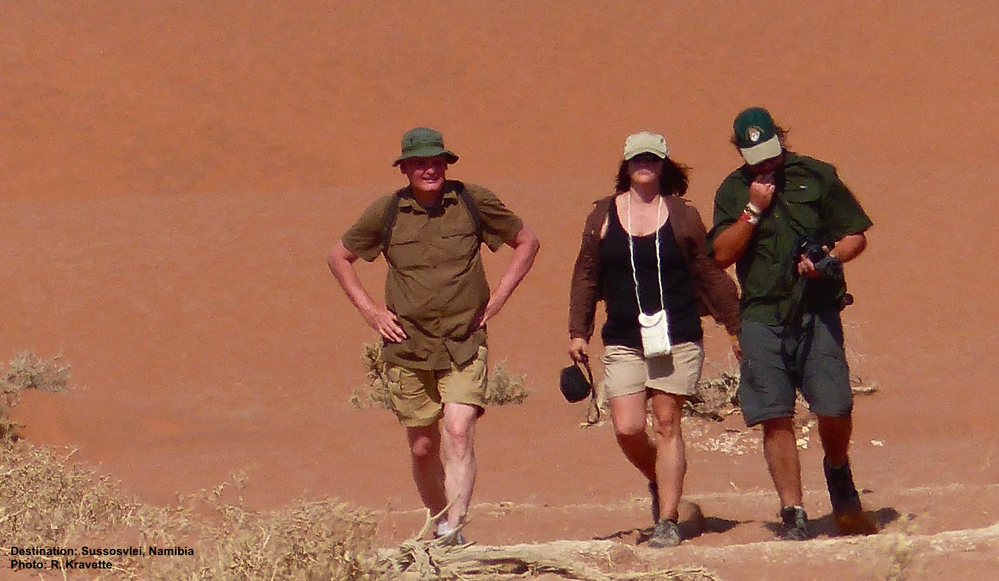 Remember that group up top? This is hours later in +100F (+38C). That wavey effect on the image is heat. while the rest of us finally got out of direct sun, these three continued up the highest dune in Sossusvlei, Namibia. when they recovered they told us why the sand was red, what kind of beetle they saw, and how old the salt flats were. Yup: Enthusiasts all three! Image: ©R. Kravette