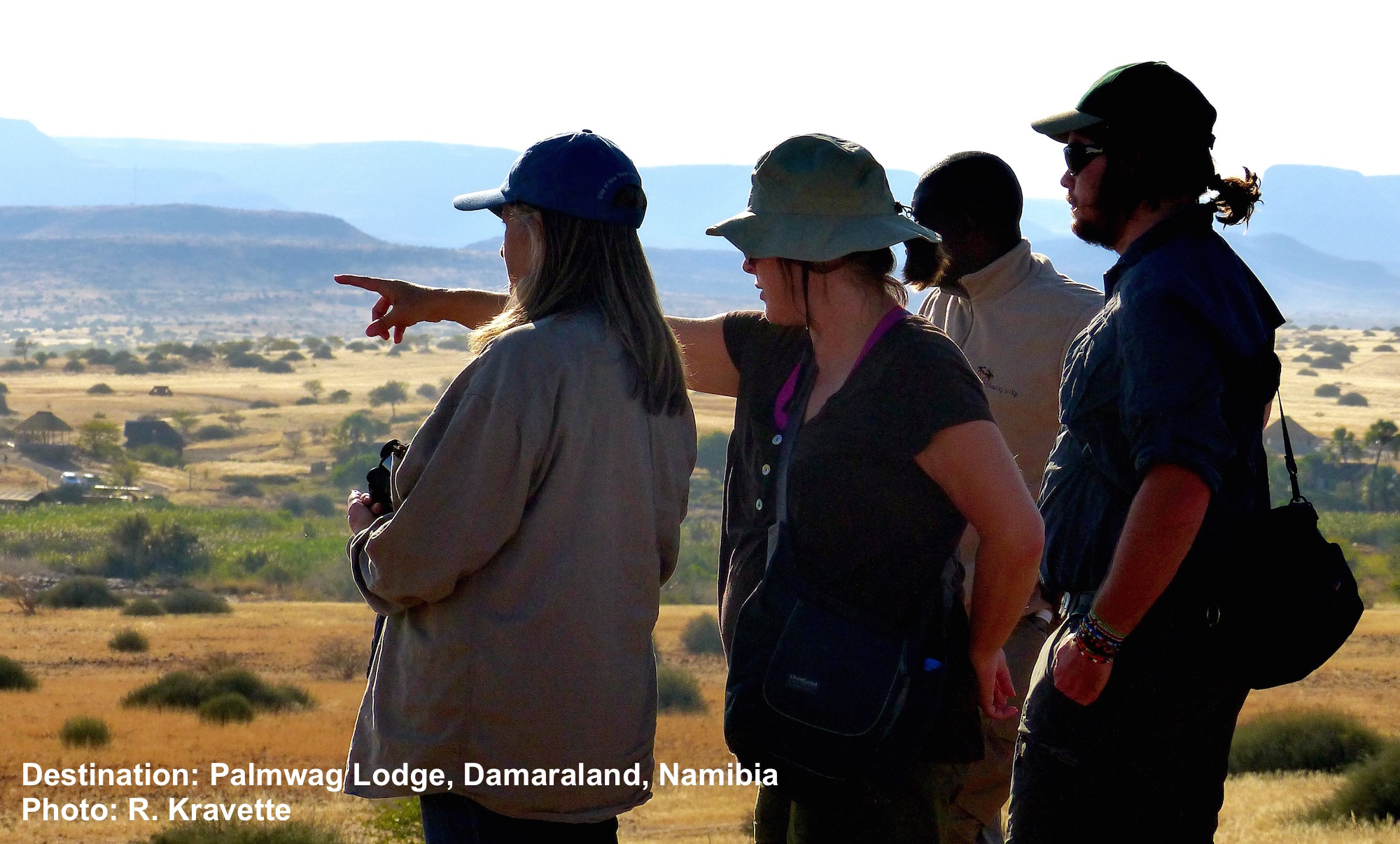 Gina points out some wildlife while Connie and Marc Cronje, our safari field guide and Erwin, the Palmwag Lodge guide watch. Image: ©R. Kravette