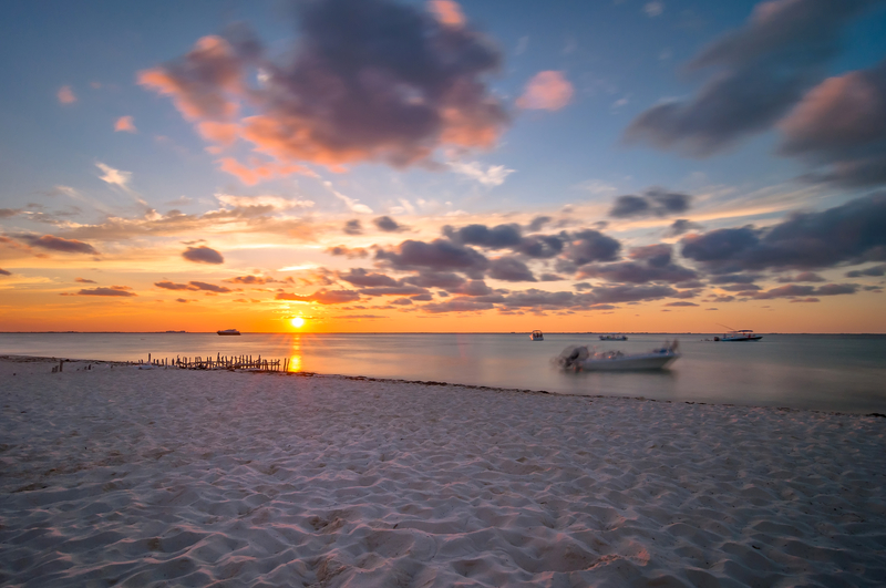Relax and enjoy the sunset after a day of swimming with the whale sharks near Isla Mujeres, Mexico. I mage ©Eddy Galleoti⎮Dreamstime.com