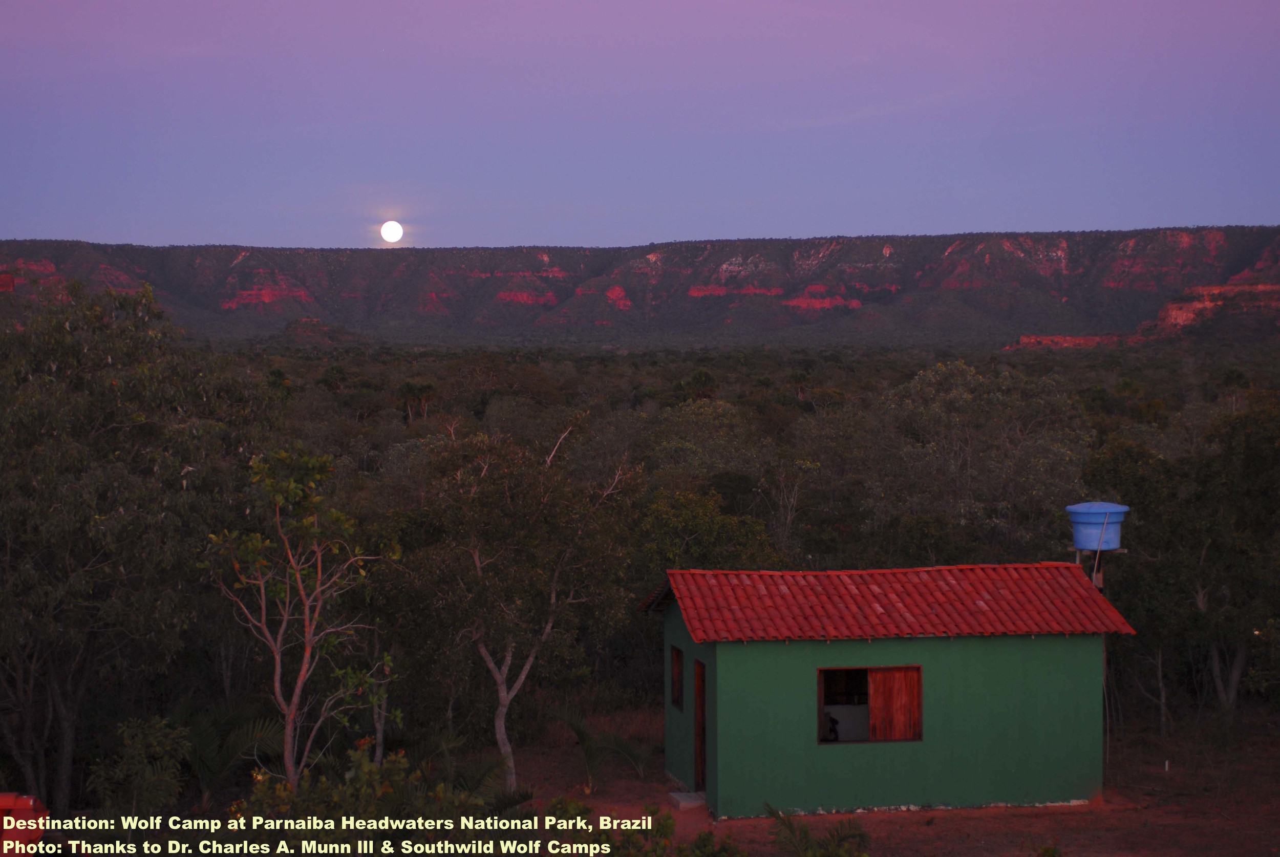 THE MOON DUCKS BEHIND THE MOUNTAIN AT THE DAWN OF ANOTHER DAY. RESPONSIBLE TOURISM CAN HELP ENSURE THAT ON THIS DAY THE HUMAN IMPACT ON THE CERRADO IS SUSTAINABLE. THE VIEW FROM WOLF CLIFFS CAMP, PARNAIBA HEADWATERS NATIONAL PARK, BRAZIL. PHOTO: DR CHARLES A. MUNN AND SOUTHWILD WOLF CAMPS.