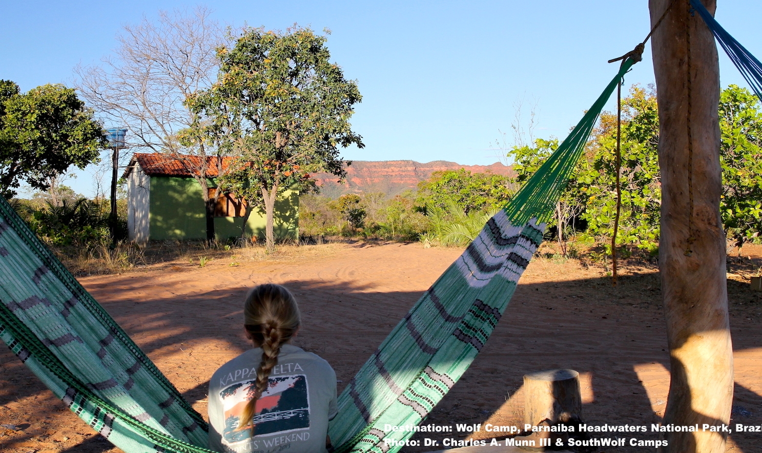 RELAXING AT WOLF CLIFF CAMP. HERE YOU CAN DRINK IN BRAZIL'S CERRADO, AN ANCIENT AND BIODIVERSE ECOSYSTEM COMPRISED OF GRASSLAND SAVANNA, WOODLAND SAVANNA, and dry FOREST AND THE UNIQUE SPECIES FOUND HERE. IMAGE: ©DR. CHARLES A. MUNN AND SOUTHWILD, BRAZIL.