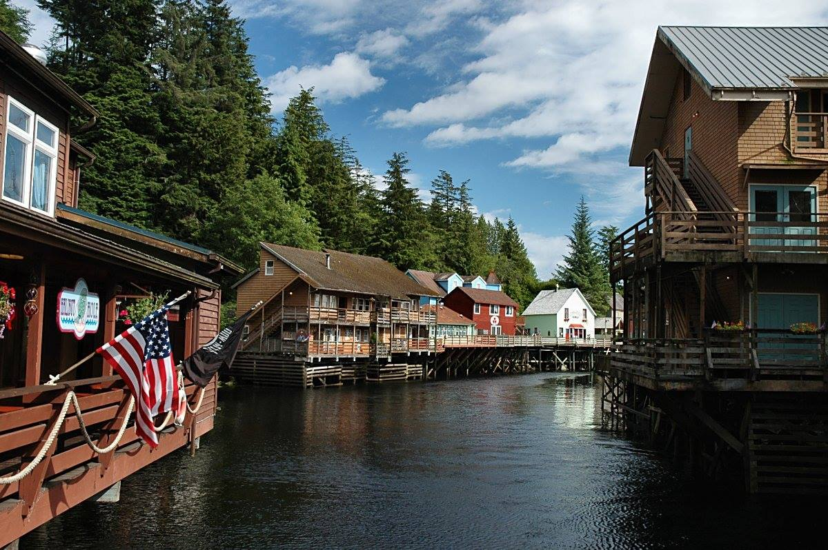 KETCHIKAN IS YOUR STARTING POINT. TAKE A SMALL PLANE OR CATCH THE FERRY TO PRINCE OF WALES ISLAND, BUT BEFORE YOU DO EXPLORE THIS COLORFUL, FRIENDLY AND FASCINATING PLACE. CREEK STREET, KETCHIKAN, ALASKA. IMAGE: THE ALASKA FACEBOOK PAGE.