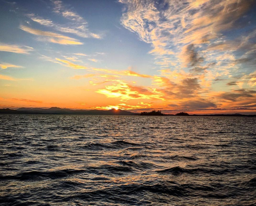THE WATERS OFF THE COMMUNITY OF COFFMAN COVE ARE PERFECT FOR WHALE WATCHING - OR CATCHING A MAGNIFICENT SUNSET FROM THE PORCH OF WHALE POINT CABIN. IMAGE: COURTESY OF WHALE POINT CABINS
