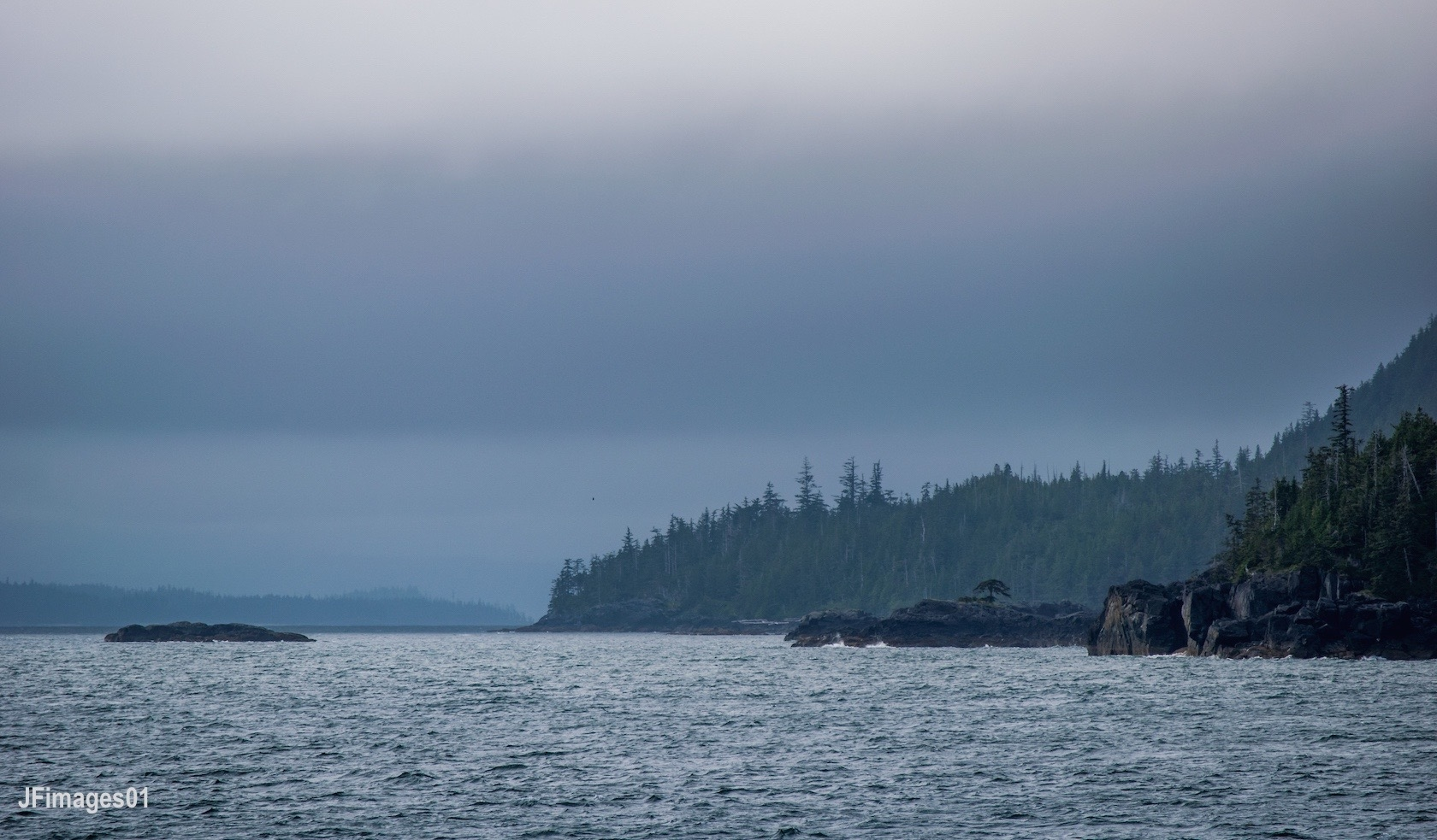THE FERRY RIDE FROM KETCHIKAN TO HOLLIS IS A MAGIC WAY TO ARRIVE AT PRINCE OF WALES ISLAND. LOOK FOR PORPOISES, WHALES, AND SEA BIRDS ALONG THE WAY. IMAGE: THANKS TO JFIMAGES01.