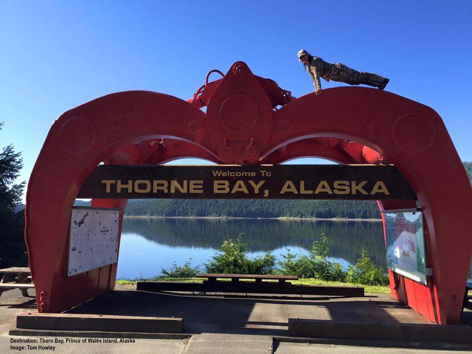 """""""THE CLAW"""" THE WORLD'S LARGEST LOG HANDLING GRAPPLES ONCE LIFTED 5 TON OLD-GROWTH LOGS. NOW RETIRED, IT WELCOMES YOU TO THORNE BAY. HIKE THE NEAR-BY TRAILS TO EXPERIENCE THE AMAZING GIANT RAINFOREST TREES THIS WAS ONCE USED TO HARVEST. IMAGE: TOM HOWLEY, visiting from Sante Fe, TEXAS. Says Tom, """"It's beautiful up there!"""" THAT'S HIS BEAUTIFUL WIFE THEMA PLANKING AT THE TOP."""