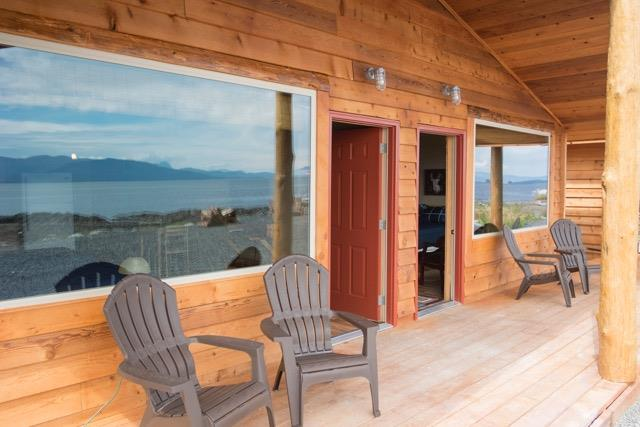 WINDOWS REFLECT THE AWESOME VIEWS FROM THE PORCH AT WHALE POINT CABINS, COFFMAN COVE. IMAGE: WHALE POINT CABINS.