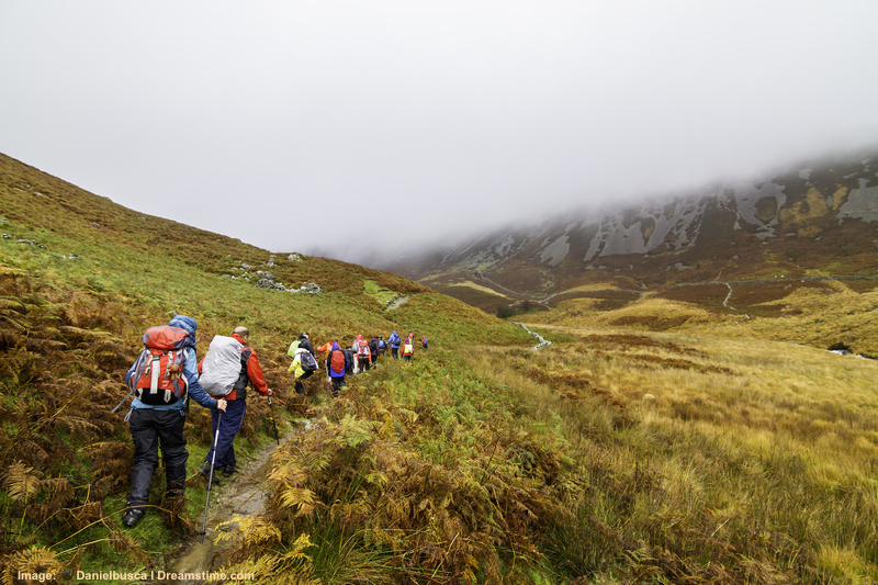 Snowdonia National Park, Wales. Too many or careless hiking, even by the best intentioned visitors, can cause erosion and other damage to delicate environments. Image:  Hikers in Snowdonia © DAnielBusca⎮Dreamstime.com