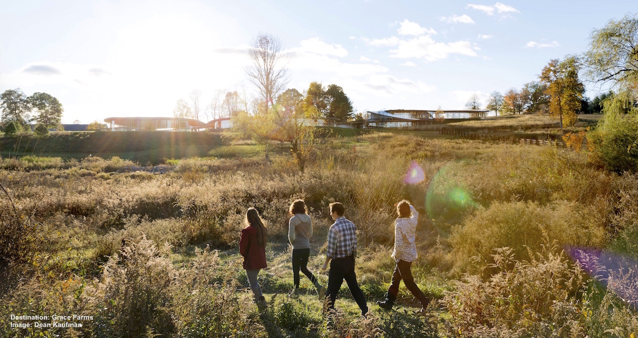 ENJOYING A WALKING TRAIL IN GRACE FARMS' BEAUTIFUL 80-ACRE PRESERVE IN NEW CANNAN, CONNECTICUT. THE RIVER BUILDING IS IN THE BACKGROUND. IMAGE: IWAN BAAN, THANKS TO THE GRACE FARMS FOUNDATION.