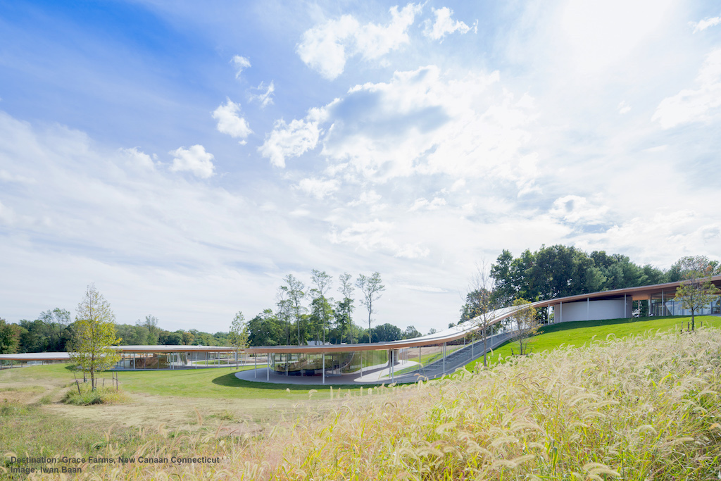 THE EARTH FRIENDLY RIVER BUILDING MEANDERS OVER THE ROLLING LANDSCAPE OF GRACE FARMS. DESIGNED BY SANAA ARCHITECTS, IT IS IN THE PROCESS OF LEED CERTIFICATION.