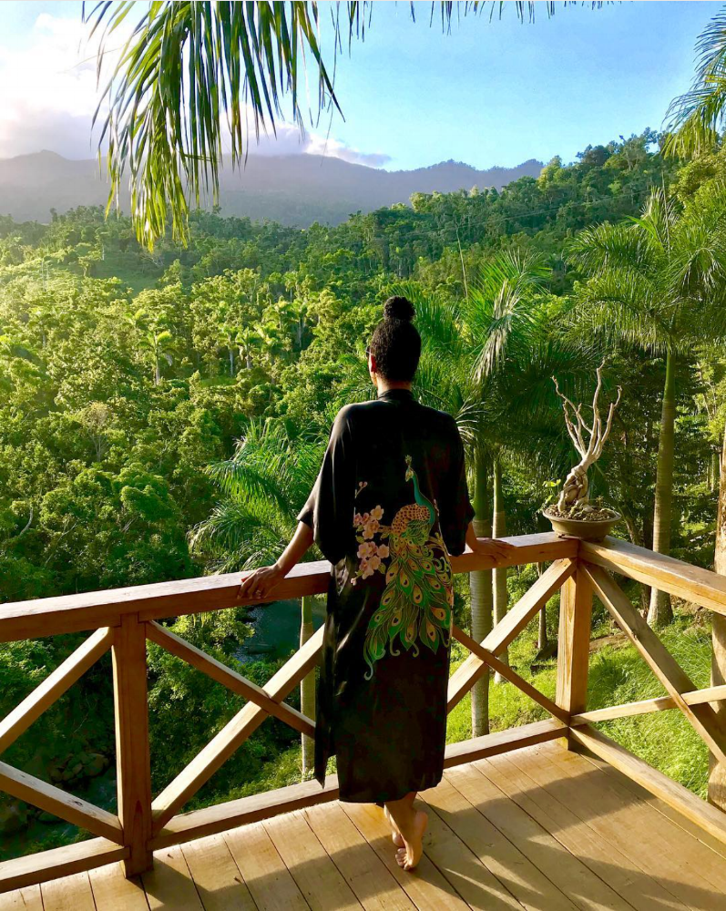 A GUEST ABSORBING THE LIGHT AND SERENITY OF YUQUYU. IMAGE COURTESTY OF D. ANDERSON PHOTOGRAPHY  Dorian Anderson