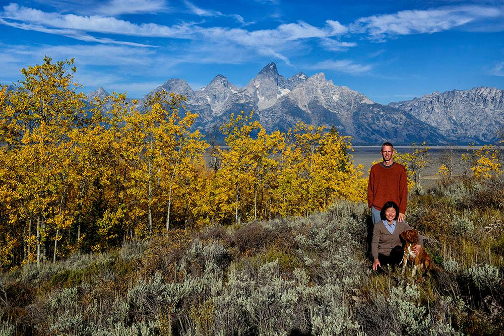 CATCHING THE AUTUMN GOLD AT GRAND TETON NATIONAL PARK IS THE PHOTOGRAPHER AND HIS WIFE AND THEIR FAVORITE TRAVELING COMPANION. IMAGE: ©JORN VANGOIDTSENHOVEN FROM    MY SEARCH FOR NTHE BEST PLACES TO FIND GRIZZLY BEARS.