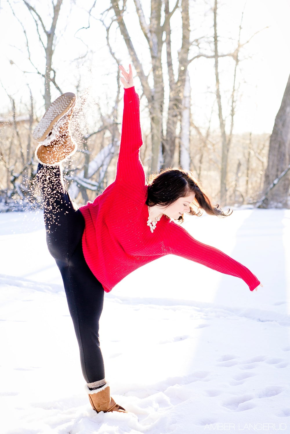 Audubon, MN Outdoor Winter Portraits | Red Sweater & Snow & Dance
