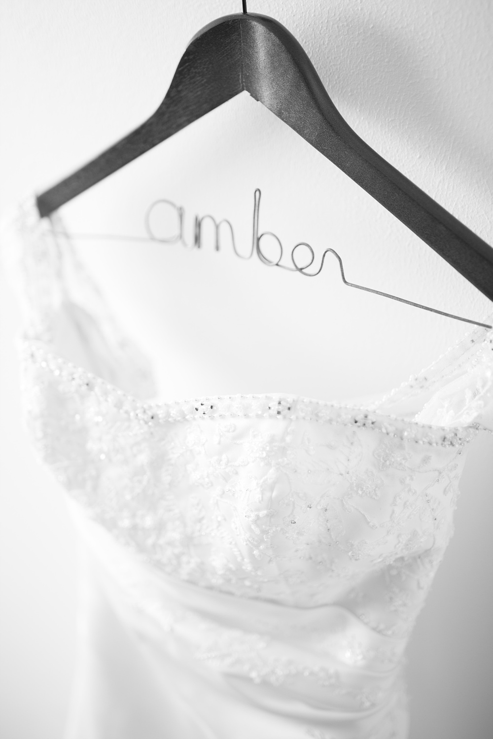 Picking the perfect hanger for your wedding dress by Amber Langerud Photography