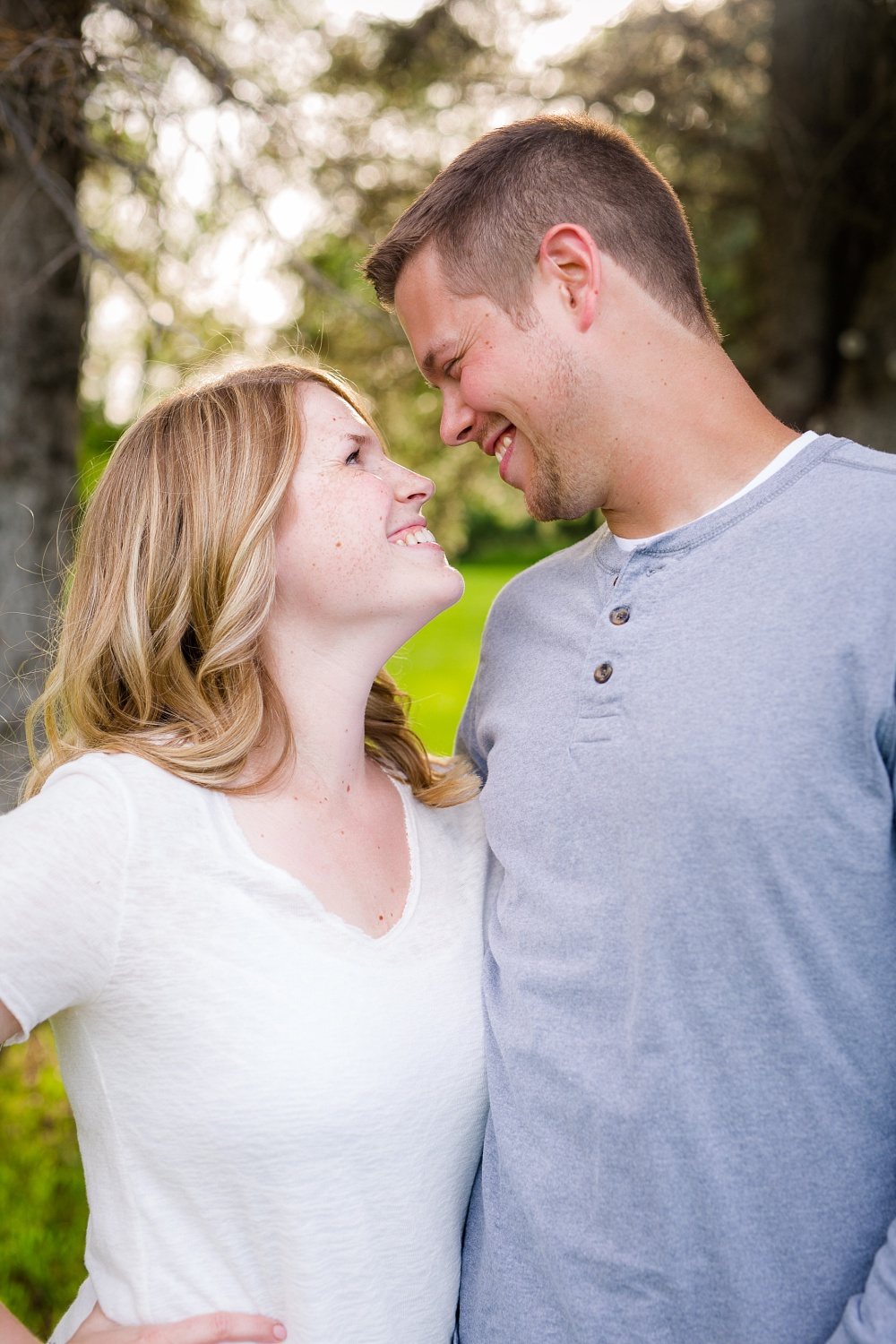 Outdoor, country styled engagement photo by pine trees near Audubon, MN | Amer Langerud Photography