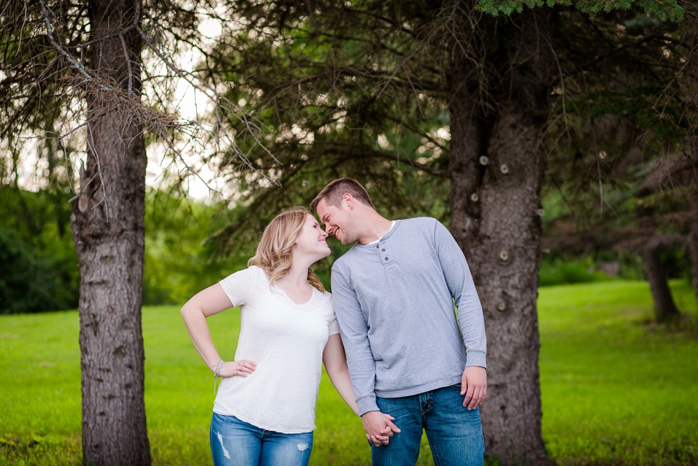 Outdoor, country styled engagement rubbing noses photo near Audubon, MN | Amer Langerud Photography