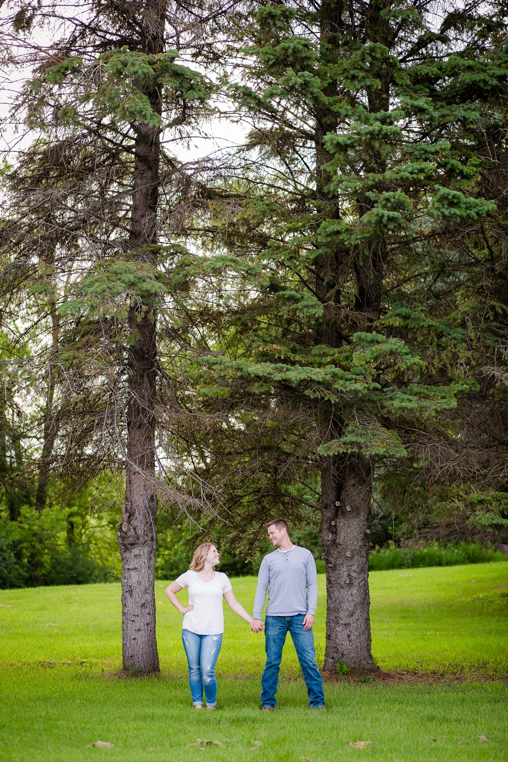 Outdoor, country styled engagement scenic pine tree portrait near Audubon, MN | Amer Langerud Photography