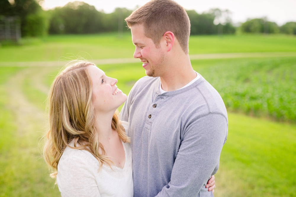 Couple looking at each other close-up | Outdoor, country styled engagement session near Audubon, MN | Amer Langerud Photography