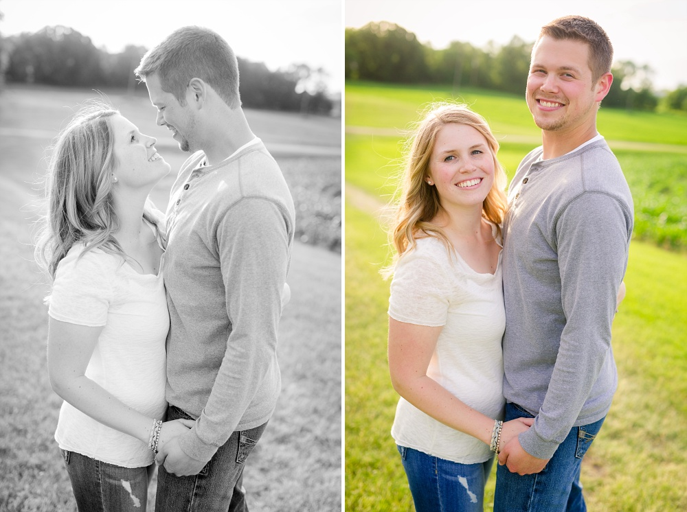 Couple standing on grass hill looking at each other | Outdoor, country styled engagement session near Audubon, MN | Amer Langerud Photography