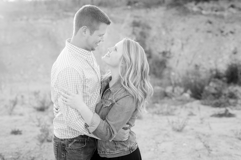 Black & White couple looking at each other | Outdoor, country styled engagement session near Audubon, MN | Amer Langerud Photography