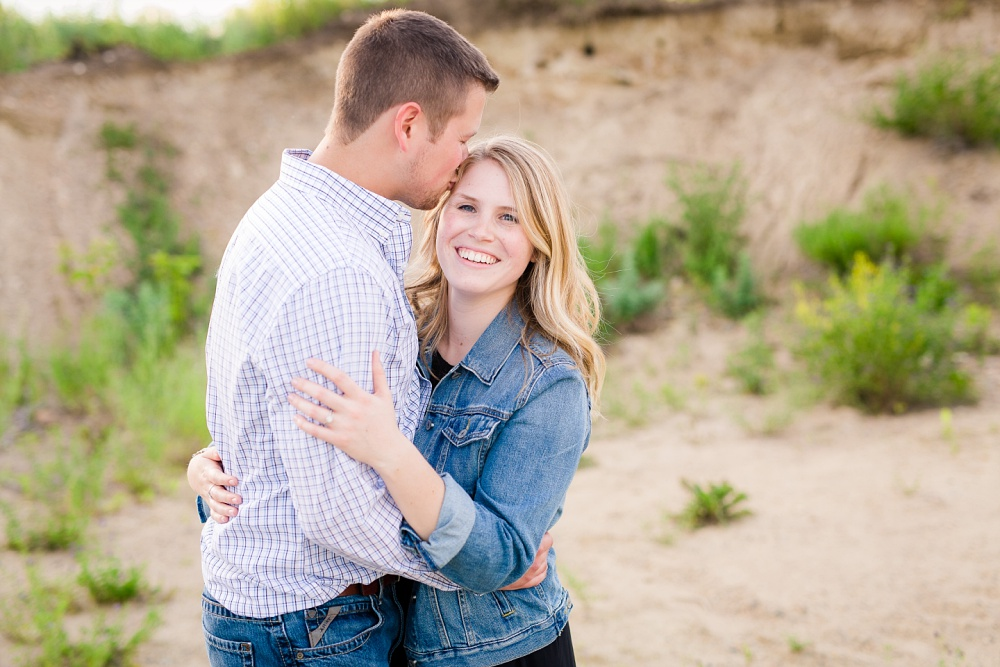 Groom to be kissing fiance on the forehead | Outdoor, country styled engagement session near Audubon, MN | Amer Langerud Photography