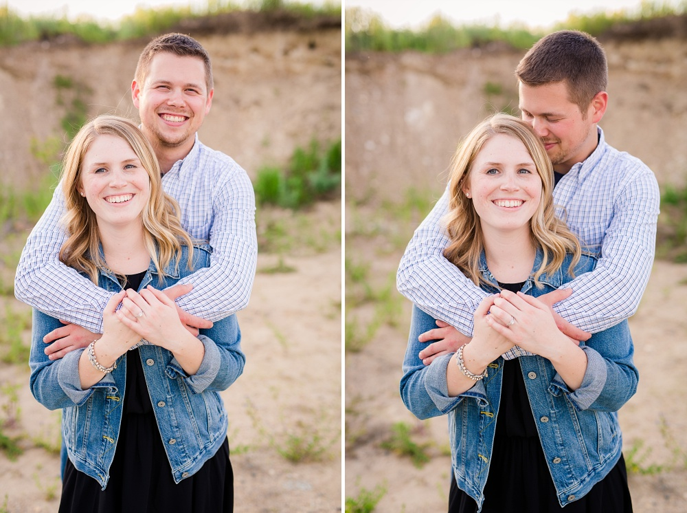 Couple with arms wrapped around each other | Outdoor, country styled engagement session near Audubon, MN | Amer Langerud Photography