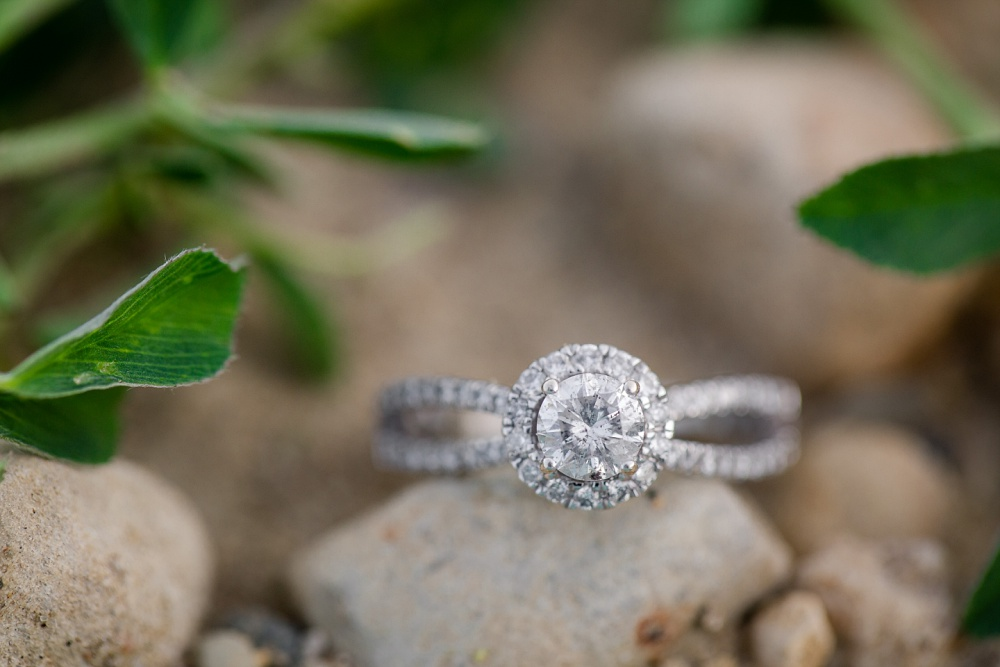 Engagement ring around rocks | Outdoor, country styled engagement session near Audubon, MN | Amer Langerud Photography