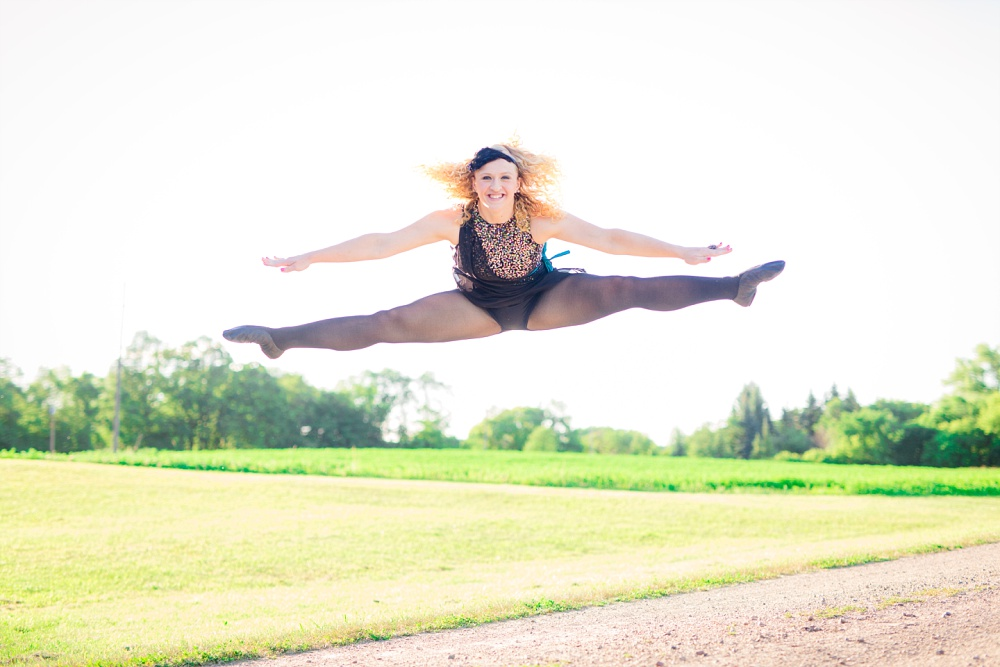 Outdoor, Country Styled High School Senior Pictures by Amber Langerud Photography | Audubon, MN | Dancer doing toe touch